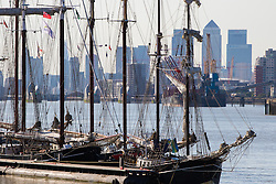 Woolwich, London, September 14th 2016. The afternoon suns illuminates the skyscrapers of Docklands and the Tall ships gathered for the Sail Greenwich Festival 2016 on the River Thames at Woolwich.  &copy;Paul Davey<br /> FOR LICENCING CONTACT: Paul Davey +44 (0) 7966 016 296 paul@pauldaveycreative.co.uk