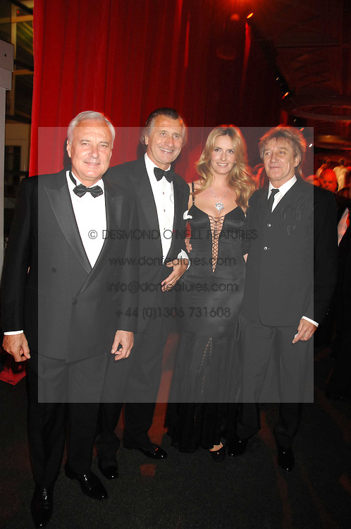 Left to right, BERNARD FORNAS, ARNAUD BAMBERGER, ROD STEWART and his wife PENNY at a dinner held at the Natural History Museum to celebrate the re-opening of their store at 175-177 New Bond Street, London on 17th October 2007.<br />