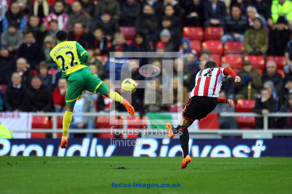 Picture by Paul Chesterton/Focus Images Ltd +44 7904 640267<br /> 21/12/2013<br /> Sunderland's Ondrej Celustka has a shot on goal during the Barclays Premier League match at the Stadium Of Light, Sunderland.