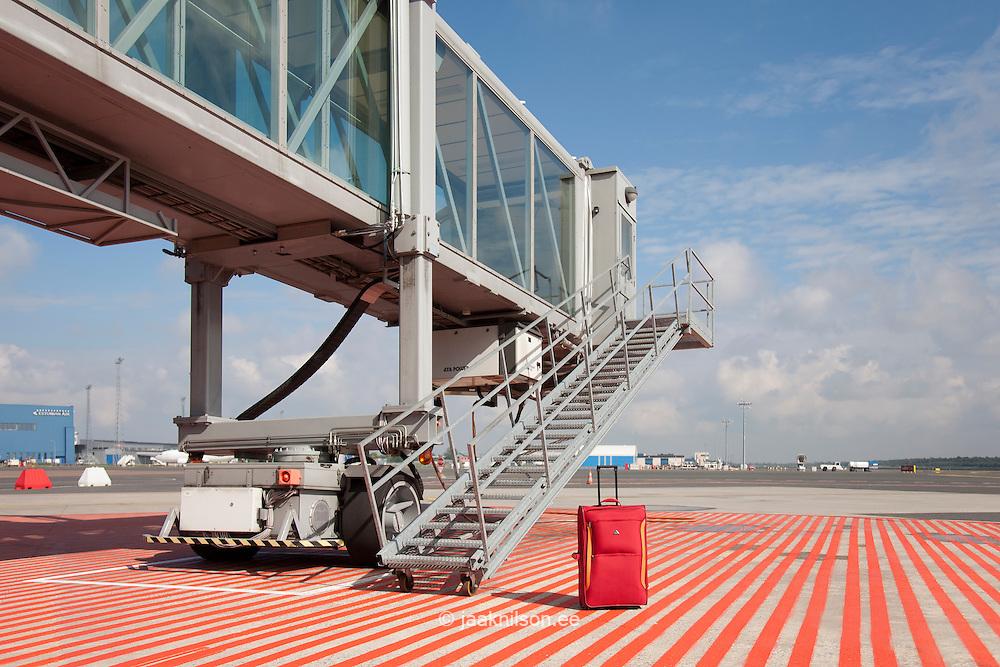 luggage at gate of boarding bridge