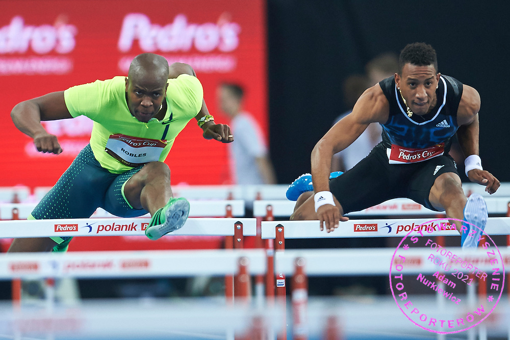 (L) Dayron Robles and (R) Orlando Ortega from Cuba compete in men's 60 meters hurdles competition during athletics meeting Pedro's Cup at Atlas Arena in Lodz, Poland.<br /> <br /> Poland, Lodz, February 17, 2015<br /> <br /> Picture also available in RAW (NEF) or TIFF format on special request.<br /> <br /> For editorial use only. Any commercial or promotional use requires permission.<br /> <br /> Adam Nurkiewicz declares that he has no rights to the image of people at the photographs of his authorship.<br /> <br /> Mandatory credit:<br /> Photo by &copy; Adam Nurkiewicz / Mediasport