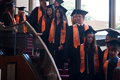 Lathan Goumas | MLive.com..Graduates wait on the stairs before the start of the 2012 Flushing High School commencement ceremony at the Whiting Theater in Flint, Mich. on Sunday June 3, 2012.