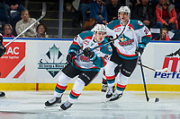 KELOWNA, CANADA - MARCH 7:  Cal Foote #25 and Kyle Topping #24 of the Kelowna Rockets skate against the Vancouver Giants on March 7, 2018 at Prospera Place in Kelowna, British Columbia, Canada.  (Photo by Marissa Baecker/Shoot the Breeze)  *** Local Caption ***