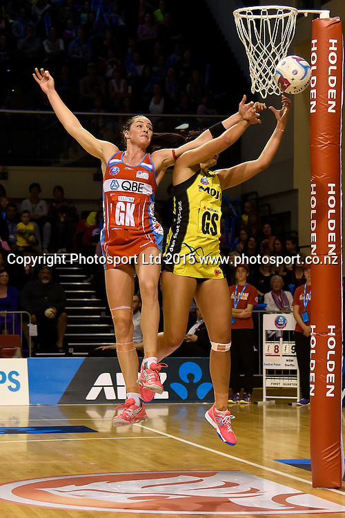 Swifts' Sharni Layton (L) blocks a pass to Pulse's Ameliaranne Wells during the ANZ Championship - Pulse v Swifts netball match at the TSB Arena in Wellington on Saturday the 25th of April 2015. Photo by Marty Melville / www.Photosport.co.nz