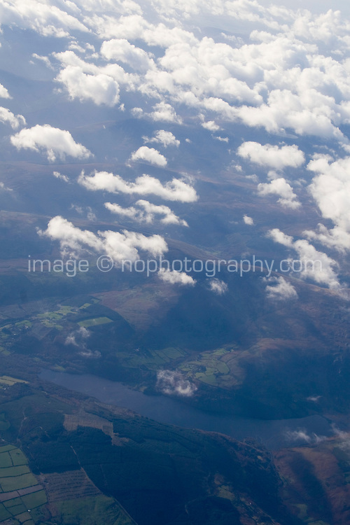 Arial view of clouds and irish landscape from Airplane