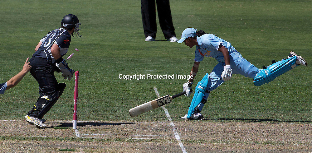Sydney-March 17:  Rachel Priest runs out Harmanpreet Kaur during the match between New Zealand and India in the Super 6 stage of the ICC Women's World Cup Cricket tournament at North Sydney  Oval, Sydney, Australia on March 17, 2009. Photo by Tim Clayton.