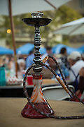 Revelers smoked flavored tobacco from hookahs during the Middle Eastern & Greek Food Fest at St. James Orthodox Church in Milpitas, California, on September 14, 2014. (Stan Olszewski/SOSKIphoto)