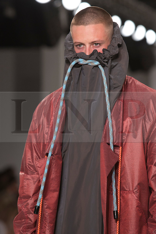 © Licensed to London News Pictures. 31/05/2014. London, England. Collection by Kirstie Lee Eells from UEL, University of East London. Graduate Fashion Week 2014, Runway Show at the Old Truman Brewery in London, United Kingdom. Photo credit: Bettina Strenske/LNP