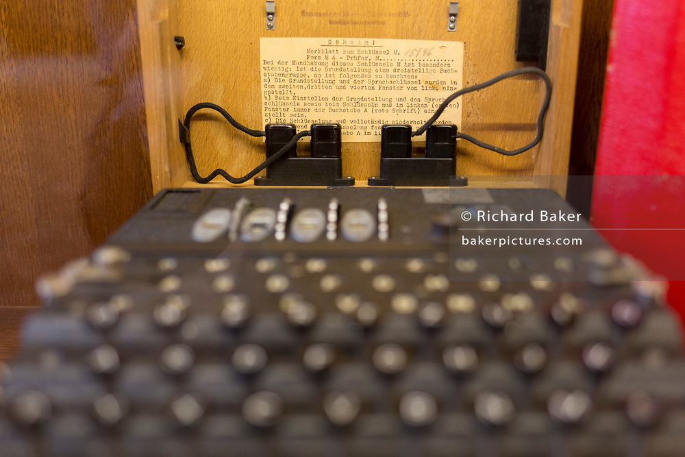 A WW2-era German secret Enigma code machine is displayed in the Locarno Dining Room, in the Foreign and Commonwealth Office (FCO), on 17th September 2017, in Whitehall, London, England. The Enigma machine is a piece of hardware invented by a German and used by Britain's codebreakers as a way of deciphering German signals traffic during World War Two. It has been claimed that as a result of the information gained through this device, hostilities between Germany and the Allied forces were curtailed by two years. An estimated 100,000 Enigma machines were constructed.