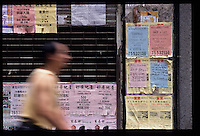 HONG KONG- OCT 28: A man walks past a closed business and for lease signs in Centraly Hong Kong, amid the Asian financial crises.  (Photo by David Paul Morris)