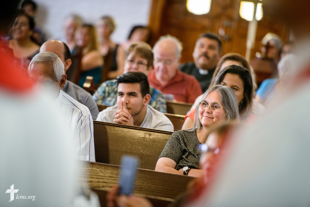 Parishioner Sara Zambrano listens during the installation service for the Rev. Dr. Antonio Lopez, new national missionary pastor at El Calvario Lutheran Church on Sunday, July 31, 2016, in Brownsville, Texas. LCMS Communications/Erik M. Lunsford