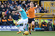 Wolverhampton Wanderers midfielder George Saville and Derby County midfielder Bradley Johnson battle for the ball during the Sky Bet Championship match between Wolverhampton Wanderers and Derby County at Molineux, Wolverhampton, England on 27 February 2016. Photo by Alan Franklin.