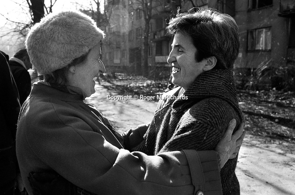 Family members greet each other after four years of separation on the Serb-side of the Bratstvo i Jedinstvo Most (Brotherhood and Unity bridge) during the final days of the siege of the city, Sarajevo, Bosnia and Herzegovina, February 1996. PHOTO BY ROGER RICHARDS