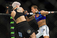 DALLAS, TX - MARCH 14:  Germaine de Randamie connects with a punch against Larissa Pacheco during UFC 185 at the American Airlines Center on March 14, 2015 in Dallas, Texas. (Photo by Cooper Neill/Zuffa LLC/Zuffa LLC via Getty Images) *** Local Caption *** Germaine de Randamie; Larissa Pacheco