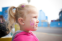 Emily Klumph gets her face painted in Downtown Newport, Oregon