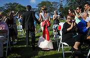Guests applaud bride and groom novelist and writer Joyce Maynard and Jim Barringer at the end of their wedding ceremony in Harrisville, N.H., Saturday, July 6, 2013.  (Cheryl Senter for the New York Times)