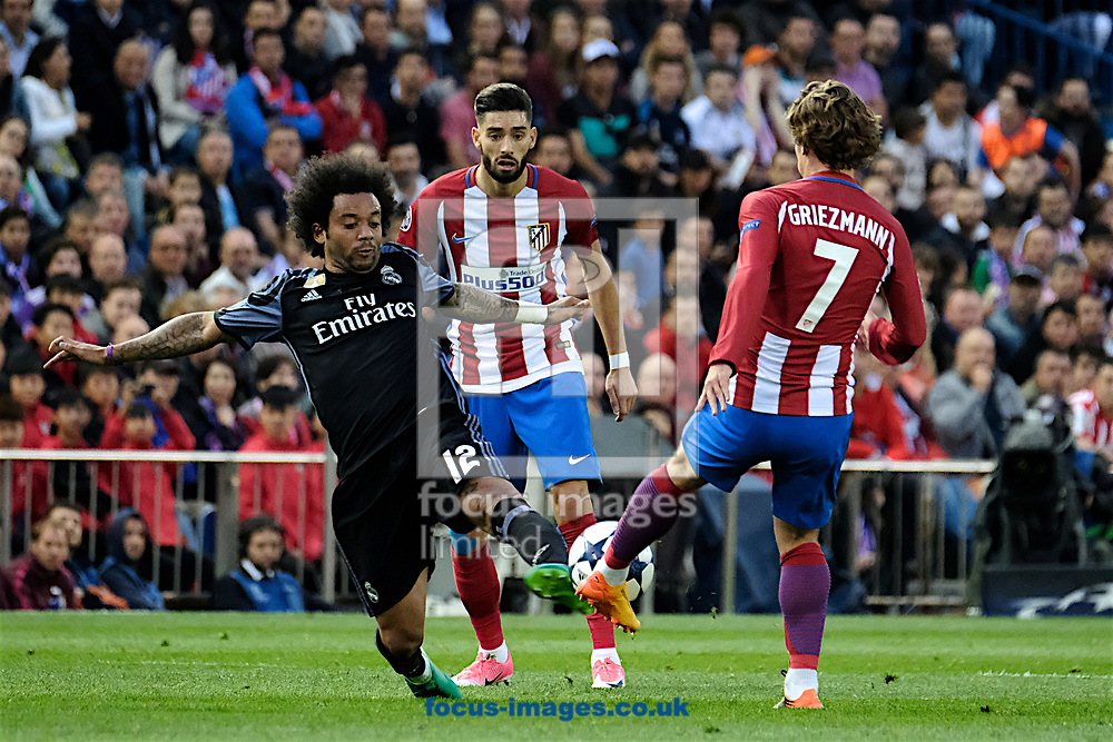 Marcelo of Real Madrid (left) and Antoine Griezmann of Atletico Madrid (right) during the second leg of the UEFA Champions League semi-final at Vicente Calderon Stadium, Madrid<br /> Picture by Kristian Kane/Focus Images Ltd +44 7814 482222<br /> 10/05/2017