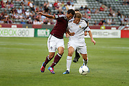 July 24th, 2012:  Colorado Rapids forward Kamani Hill (13) has the ball stolen by Swansea City AFC midfielder Mark Gower (27) in the Colorado Rapids 2-1 victory over Swansea City AFC for a international friendly soccer match in Denver, CO.