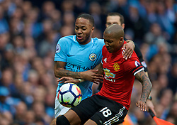 MANCHESTER, ENGLAND - Saturday, April 7, 2018: Manchester City's Raheem Sterling and Manchester United's Ashley Young during the FA Premier League match between Manchester City FC and Manchester United FC at the City of Manchester Stadium. (Pic by David Rawcliffe/Propaganda)