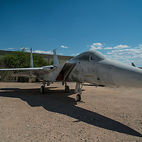 A McDonnell Douglas f-15a Eagle Fighter originally photographed at the Pima Aerospace museum in Tucson Arizona. The Eagle was designed in the late 1960s in response to an Air Force request for a new air superiority fighter. The McDonnell-Douglas design was accepted by the Air Force in December 1969. One of the primary requirements for the aircraft was that it be very maneuverable at a wide range of speeds and altitudes. Many of the Eagle's design features, including; the twin tails, two engines and large-area wing, are a result of this requirement. At a normal weight the F-15A has a thrust to weight ratio of 1.17 to 1. This means that for every pound of weight of the aircraft, the engines produce 1.17 pounds of thrust giving the Eagle the ability to accelerate straight up. Later versions of the Eagle remain the primary air superiority fighter for the U.S. Air Force, but are beginning to be replaced by the F-22 Raptor.<br />