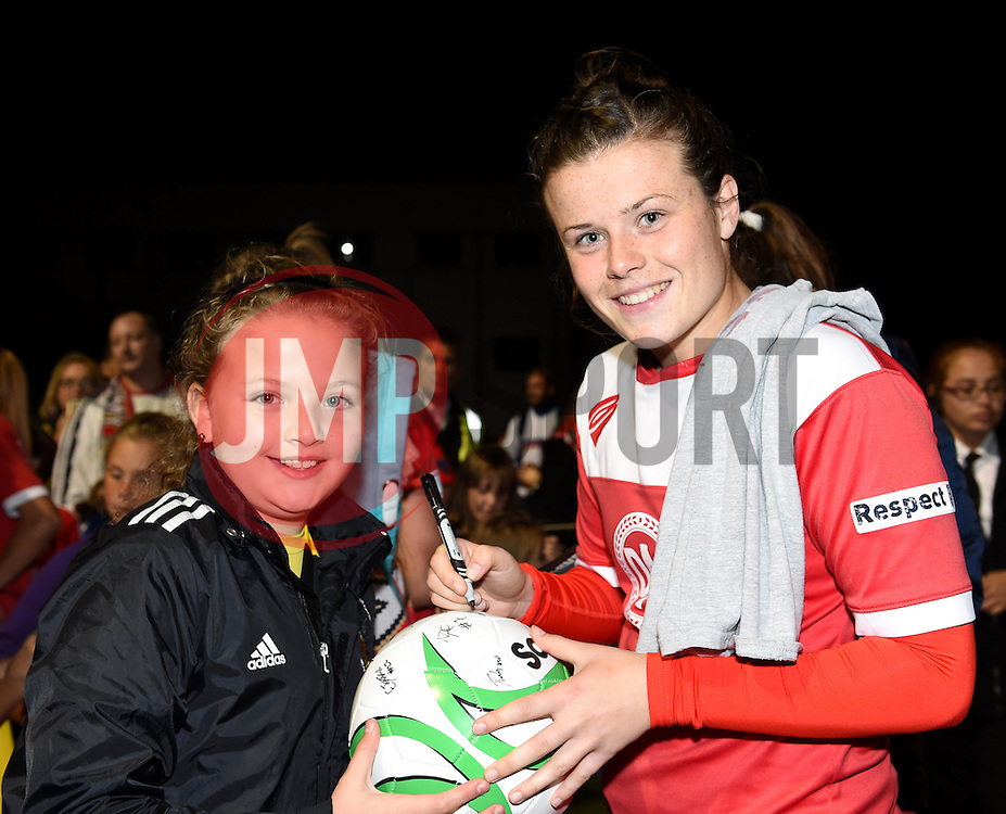 Hayley Ladd of Bristol Academy Women autographs a young fan's ball - Mandatory by-line: Paul Knight/JMP - Mobile: 07966 386802 - 04/10/2015 -  FOOTBALL - Stoke Gifford Stadium - Bristol, England -  Bristol Academy Women v Liverpool Ladies FC - FA Women's Super League