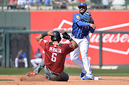 SURPRISE, AZ - MARCH 06:  Christian Colon #24 of the Kansas City Royals turns the double play over the sliding David Peralta #6 of the Arizona Diamondbacks in the fourth inning of the spring training game at Surprise Stadium on March 6, 2017 in Surprise, Arizona.  (Photo by Jennifer Stewart/Getty Images)