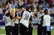 NZ Celebrate a wicket during the first ICC Twenty20 (Twenty Twenty) match between Pakistan and New Zealand held at the Dubai International Cricket Stadium, Dubai, UAE, 12 November, 2009. Photo: SPORTDXB / PHOTOSPORT