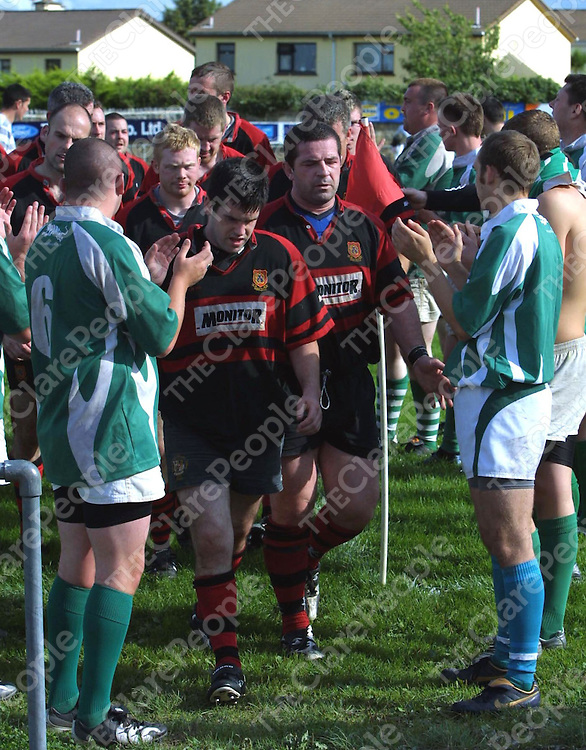 The Ennis players are applauded off the field after the Colm Flynn Memorial Cup game against Richmond.