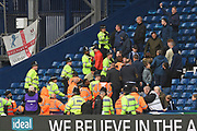 Police ushering the Millwall fans away from the West Bromwich Albion fans during the EFL Sky Bet Championship match between West Bromwich Albion and Millwall at The Hawthorns, West Bromwich, England on 22 September 2018.