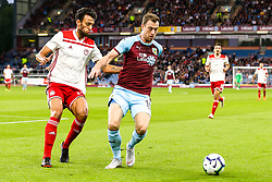 Ashley Barnes of Burnley takes on Andreas Bouhalakis of Olympiakos - Mandatory by-line: Robbie Stephenson/JMP - 30/08/2018 - FOOTBALL - Turf Moor - Burnley, England - Burnley v Olympiakos - UEFA Europa League Play-offs second leg