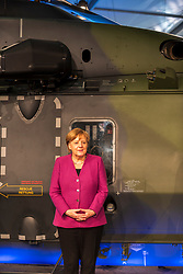 April 25, 2018 - Berlin, Berlin, Germany - Chancellor of the Federal Republic of Germany, Angela Merkel of the Christian Democratic Union (CDU) stands in front of a military helicopter during the opening on the first day of the International Air and Space Exhibition at Schoenefeld Airport. Over 150,000 visitors will visit the Civil and Military Aerospace Fair. (Credit Image: © Markus Heine/SOPA Images via ZUMA Wire)
