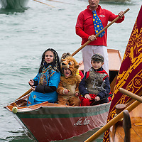 VENICE, ITALY - FEBRUARY 16:  Rowers dresses with  costumes take part in the traditional regatta pn the Grand Canal which officially opens the Venice Carnival  on February 16, 2014 in Venice, Italy. The 2014 Carnival of Venice will run from February 15 to March 4 and includes a program of gala dinners, parades, dances, masked balls and music events.  (Photo by Marco Secchi/Getty Images)