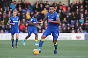 AFC Wimbledon midfielder Liam Trotter (14) dribbling during the EFL Sky Bet League 1 match between AFC Wimbledon and Walsall at the Cherry Red Records Stadium, Kingston, England on 25 November 2017. Photo by Matthew Redman.