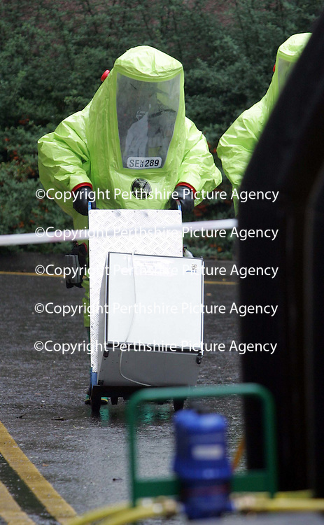 Firefighters in chemical protection suits make their out of Drumhar Health Centre in Perth with the fridge that caused the ammonia leak.  <br /><br />Picture by Graeme Hart.<br />Copyright Perthshire Picture Agency<br />Tel: 01738 623350  Mobile: 07990 594431