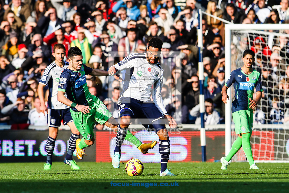 Joleon Lescott of West Bromwich Albion (centre) during the Barclays Premier League match at The Hawthorns, West Bromwich<br /> Picture by Andy Kearns/Focus Images Ltd 0781 864 4264<br /> 09/11/2014