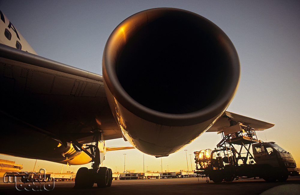 Close-up on jet engine at sunset