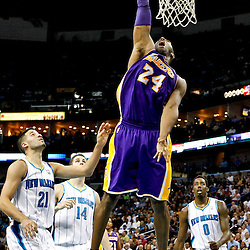 Dec 5, 2012; New Orleans, LA, USA; Los Angeles Lakers shooting guard Kobe Bryant (24) dunks over New Orleans Hornets point guard Greivis Vasquez (21) and power forward Jason Smith (14) and small forward Al-Farouq Aminu (0) during the second quarter of a game at the New Orleans Arena.  Mandatory Credit: Derick E. Hingle-USA TODAY Sports