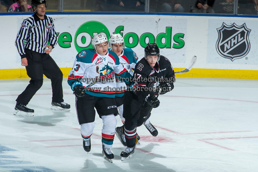 KELOWNA, CANADA - NOVEMBER 11: Colum McGauley #23 and Marek Skvrne #9 of the Kelowna Rockets check Reese Johnson #17 of the Red Deer Rebels  on November 11, 2017 at Prospera Place in Kelowna, British Columbia, Canada.  (Photo by Marissa Baecker/Shoot the Breeze)  *** Local Caption ***