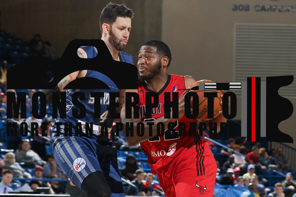 Windy City Bulls Forward DAVID LAURY III (22) drives towards the basket as Delaware 87ers Forward CARLOS LOPEZ-SOSA (4) defends in the second half of an NBA D-league regular season game between the Delaware 87ers and the Windy City Bulls (Chicago Bulls) Saturday, March 25, 2017 at The Bob Carpenter Sports Convocation Center in Newark, DEL