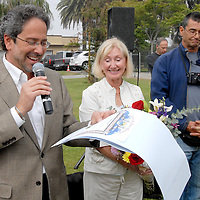 Santa Monica Mayor Richard Bloom presents a city commendation to Brenda Katz during the Herb Katz Dog Park dedication ceremony at Joslyn Park  on Thursday, May 5, 2011.