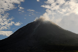June 14, 2017 - North Sumatera, Indonesia - Mount Sinabung continued its eruption with fully smoked on the top, seen from Perteguhen village, Karo district. (Credit Image: © Sabirin Manurung/Pacific Press via ZUMA Wire)