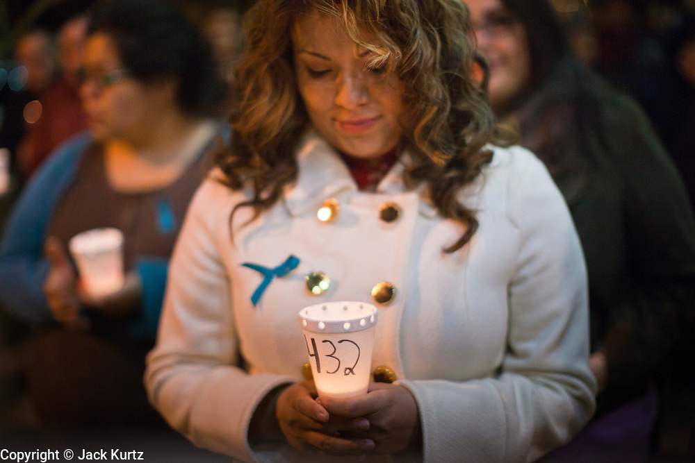 22 DECEMBER 2011 - PHOENIX, AZ: A woman carries a lit candle during vigil against sexual assault in Phoenix. About 300 people marched through downtown Phoenix Thursday night in a silent candle lit procession to protest against the way the Maricopa County Sheriff's Department, led by Sheriff Joe Arpaio, has conducted sexual assault and rape investigations. Two recent media reports, one by the East Valley Tribune, a newspaper in Mesa, AZ, and one by the Associated Press concluded that the Sheriff's department has bungled more than 430 rape investigations. Last week, a US Department of Justice report cited the unresolved rape investigations along with evidence of wide spread racial profiling by the sheriff's department in a report that was highly critical of Sheriff Arpaio and the Sheriff's Department.    PHOTO BY JACK KURTZ