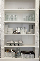 Tableware arranged in shelf