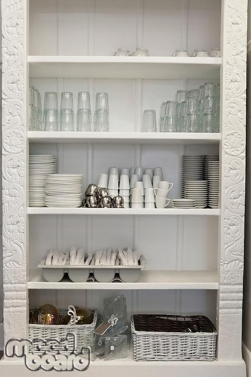 Tableware arranged in shelf
