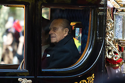 London, October 20th 2015. Following a Ceremonial welcoming to the UK by the Queen and The Duke of Edinburgh at Horse Guards Parade, a procession of carriages travels down the Mall past thousands of Chinese expatriates and Tibetan protesters. PICTURED: The Duke of Edinburgh Prince Philip travels along the Mall in a carriage with Madame Peng