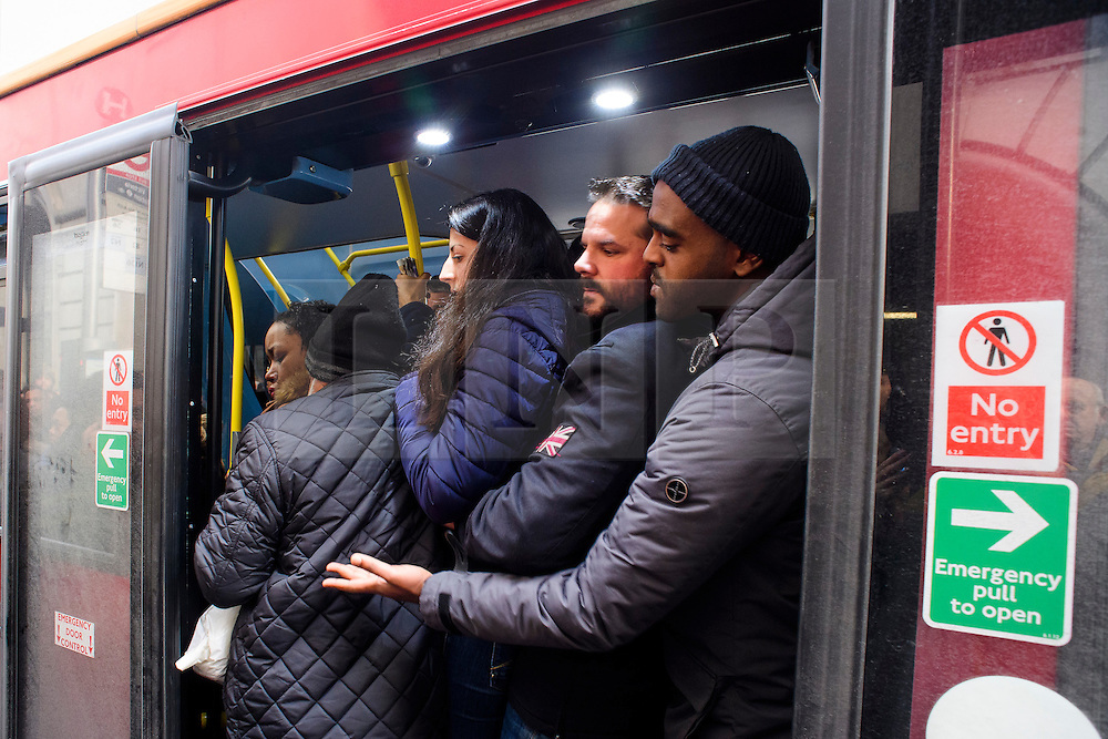 © Licensed to London News Pictures. 09/01/2017. London, UK.  Commuters squeeze on to a bus at Victoria station in London on the second day of a 24 hour tube strike.  All Zone one tube stations are closed until 6PM tonight after members of the RMT and the Transport Salaried Staffs' Association unions walked out after talks with TFL collapsed. Photo credit: Ben Cawthra/LNP