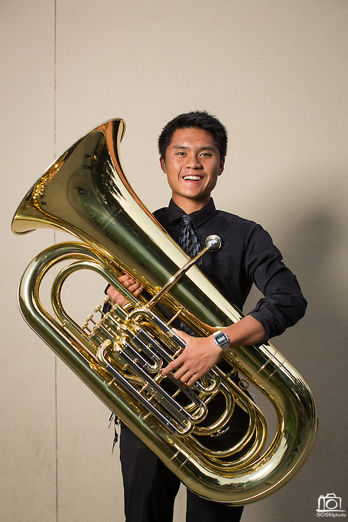 Michael Le, MHS senior, poses for a portrait with his tuba before performing in the Milpitas Unified School District's 11th Annual Music Festival at Milpitas High School in Milpitas, California, on April 10, 2014. (Stan Olszewski/SOSKIphoto)