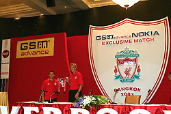 BANGKOK, THAILAND - Thursday, July 22, 2003: Liverpool's Michael Owen and Sami Hyypia parade the League Cup at a press conference at the Merchant Court Hotel in Bangkok, ahead of their preseason match against Thailand. (Pic by David Rawcliffe/Propaganda)