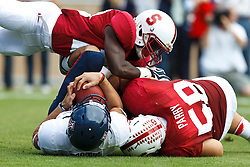 PALO ALTO, CA - OCTOBER 06: Quarterback Matt Scott #10 of the Arizona Wildcats is sacked by defensive tackle David Parry #58 of the Stanford Cardinal during the first quarter at Stanford Stadium on October 6, 2012 in Palo Alto, California. The Stanford Cardinal defeated the Arizona Wildcats 54-48 in overtime. (Photo by Jason O. Watson/Getty Images) *** Local Caption *** Matt Scott; David Parry