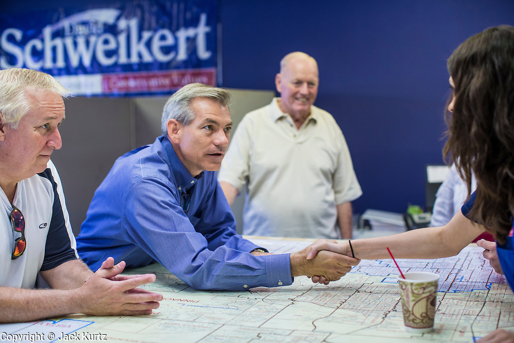 02 JUNE 2012 - PHOENIX, AZ:  Congressman DAVID SCHWEIKERT (R-AZ) introduces himself to campaign volunteers Saturday. Schweikert met with his campaign staff and volunteers for a pancake breakfast Saturday morning at the campaign headquarters to talk to them about the upcoming primary election against fellow Republican Ben Quayle. Republican incumbents Schweikert and Quayle will face each other in Arizona's Aug. 28 primary election. Redistricting because of the census has thrown the two conservative freshman Republican Congressmen into Arizona's 6th Congressional District. The district is made up of mostly upper middle class neighborhoods in north Phoenix and the wealthy suburban communities of Scottsdale, Fountain Hills and Cave Creek. The District is strongly Republican and whoever wins the Republican primary is expected to easily win November's general election.        PHOTO BY JACK KURTZ